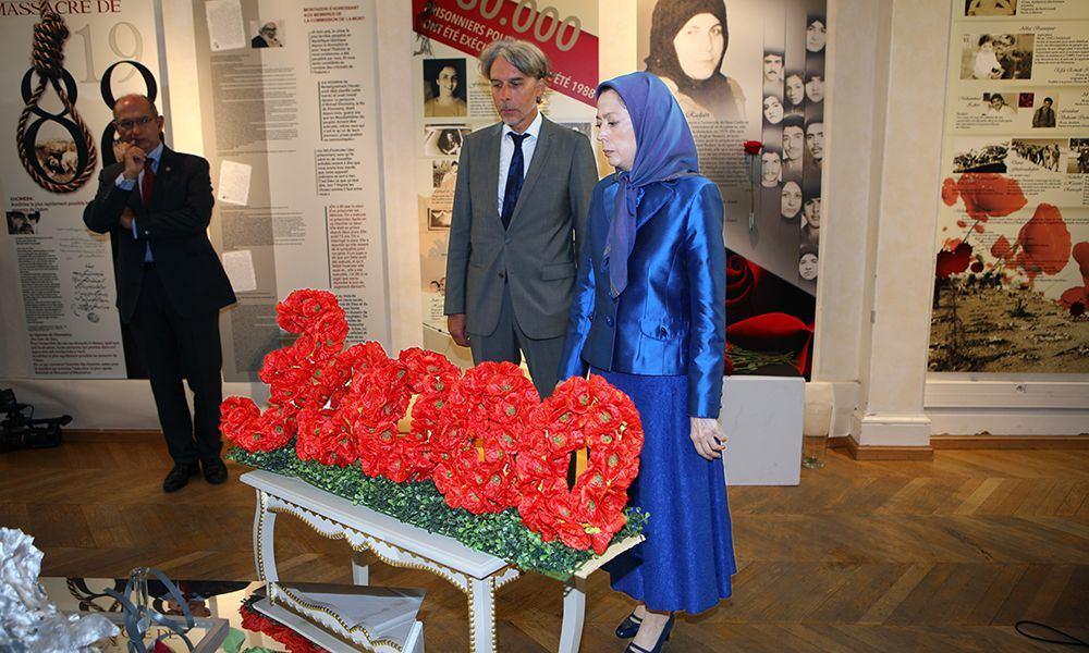 Maryam Rajavi visits photo exhibition of 1988 massacred political prisoners at Paris 2nd district