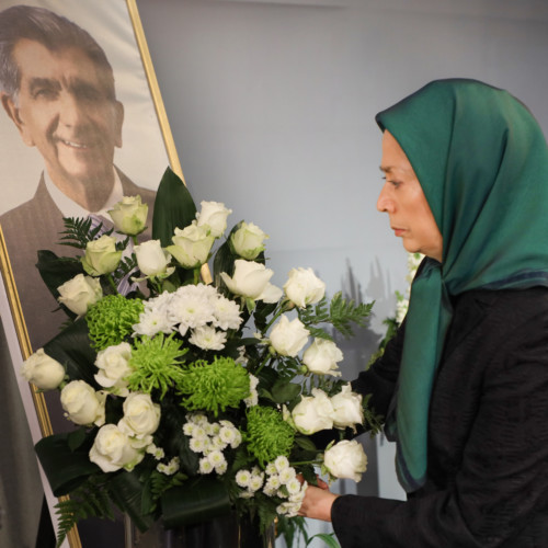 Putting flowers for Samad Sajedian, a member of PMOI who recently passed away