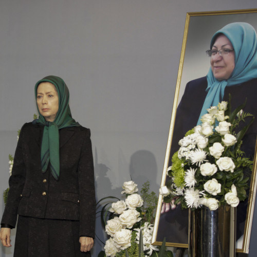 Putting flowers for Behnaz Mojalal, a member of PMOI who recently passed away