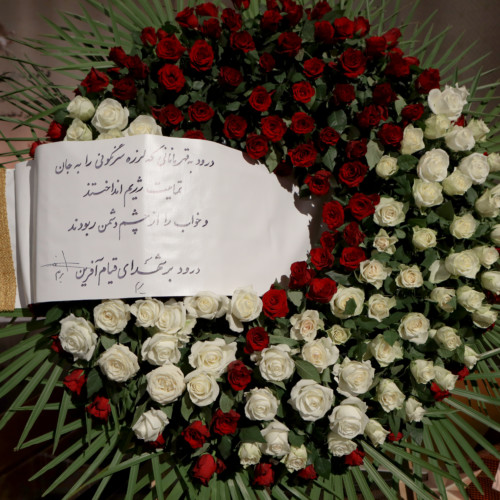 Putting flowers in the memory of November 2019 uprising