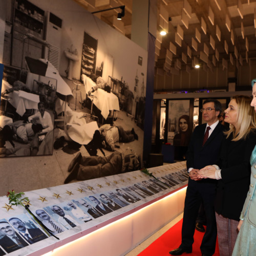 Monika Kryemadhi and Maryam Rajavi visit the exhibition of the Iranian people's 120 years of struggle for freedom – standing by the images of martyrs of the massacre in Asharf on September 1, 2013