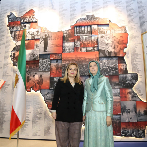 Monika Kryemadhi and Maryam Rajavi in front of the memorial of 120,000 members of the Iranian Resistance fallen for freedom and the list of PMOI martyrs