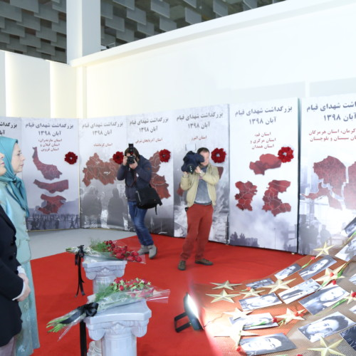Maryam Rajavi, Monika Kryemadhi and her accompanying delegation visit the exhibition of 120 years of the Iranian people's struggle for freedom - standing beside the memorial of 1,500 martyrs of the Iran Uprising in November 2019