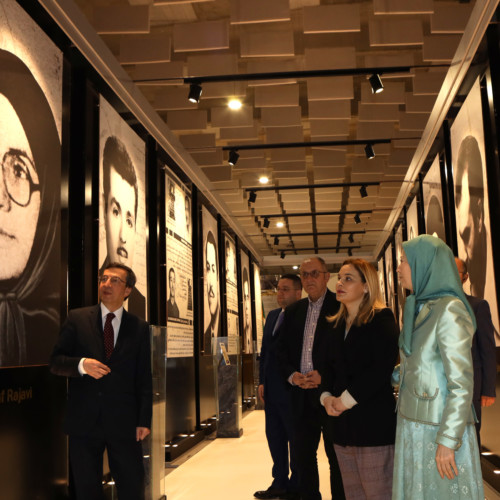 Maryam Rajavi, Monika Kryemadhi and her accompanying delegation visit the exhibition of 120 years of the Iranian people's struggle for freedom - standing before the portrait of Ashraf Rajavi