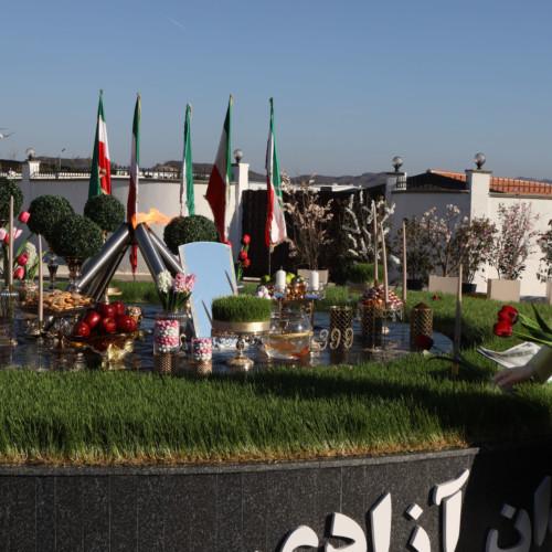 Maryam Rajavi standing beside the New Year Haft Sin arrangement and the beacon of freedom, Nowruz 1399