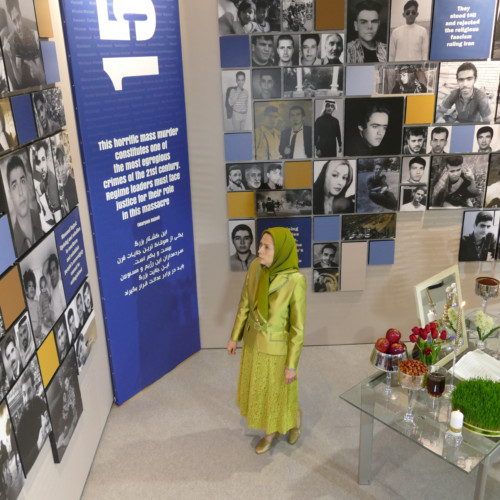Visiting the Exhibition on 120 years of struggle of the people of Iran for freedom on the eve of the New Persian Year, Maryam Rajavi stands in front of the pictures of 1,500 martyrs of the Iran Uprising in November 2019