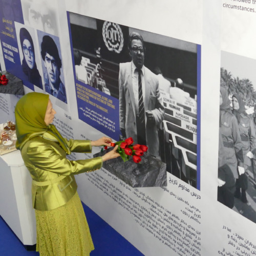 In her New Year visit to the Exhibition of the Iranian People's 120 Years of Struggle for Freedom, Maryam Rajavi lays flowers at the protrait of Prof. Kazem Rajavi, the great martyr for human rights