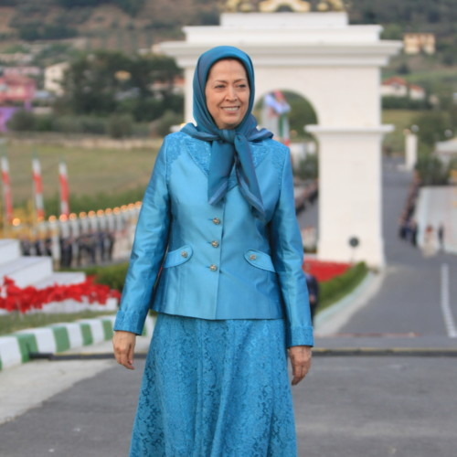 Maryam Rajavi standing in front of monument dedicated to Iran uprising and youth rising up against the mullahs' dicatorship – Ashraf 3, July 17, 2020.