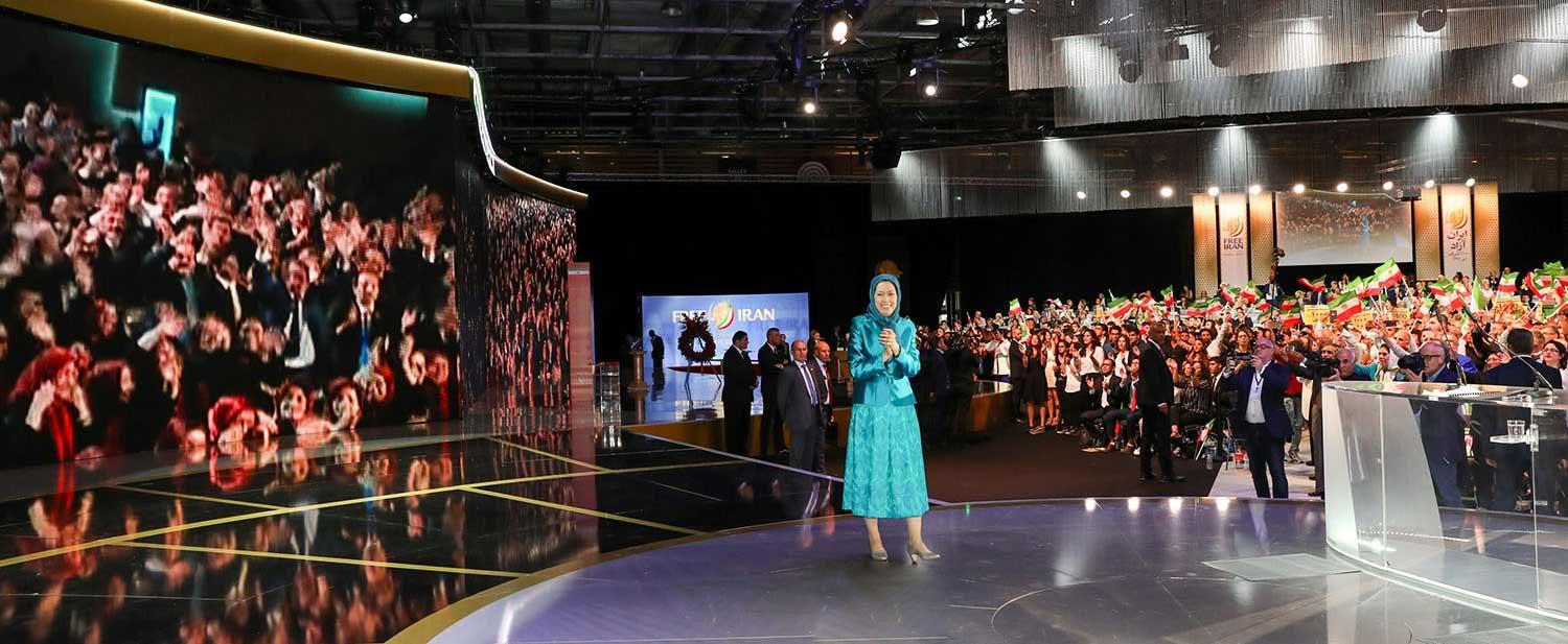 Maryam-Rajavi-and-audience-in-Free-Iran-gathering-applaud-live-contact-with-PMOI-freedom-fighters-in-Albania-Villepinte-July-1-2017