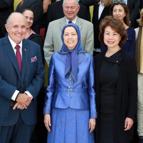 Maryam Rajavi, with Rudi Giuliani, Elaine Chao, Robert Pittenger, Mrs Rohrabacher, Dana Rohrabacher,  Ingrid Betancourt and Maria Tereza Fernandez at the grand annual gathering in Paris _43