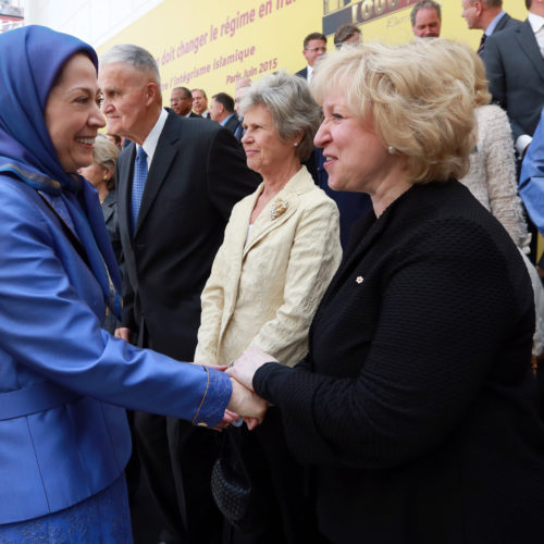 Maryam Rajavi, Iranian opposition leader talking to Mrs Kim Campbell at the grand annual gathering in Paris _56